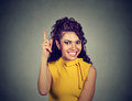 Woman pointing finger up has a brilliant idea Royalty Free Stock Photo