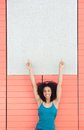 Woman pointing fingers to blank poster portrait of a happy young Royalty Free Stock Photos