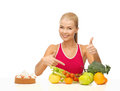 Woman pointing at healthy food with fruits and cake Stock Photography