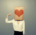 Woman pointing at heart on paper Royalty Free Stock Photo