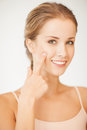 Woman pointing at her cheek Royalty Free Stock Image