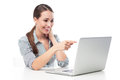 Woman pointing at laptop smiling Royalty Free Stock Images