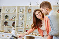 Woman pointing to necklace happy women with men in a jewelry store Stock Images