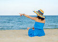 Woman pointing to the ocean Royalty Free Stock Photo