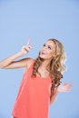 Woman pointing upwards to blank copyspace Royalty Free Stock Photography