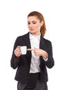 Woman pointing at a white cup of hot drink elegance business full length studio shot isolated on Royalty Free Stock Image