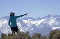 Woman points to distant mountain a towards a sierra nevada peak Stock Photography