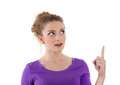 Woman points up woman isoalted on white background young something with her finger purple Stock Photos