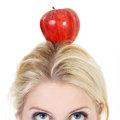 Woman poised with an apple beautiful Royalty Free Stock Photo