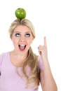 Woman poised with an apple beautiful Royalty Free Stock Images