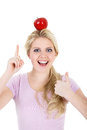 Woman poised with an apple beautiful Stock Photo