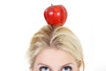Woman poised with an apple beautiful Royalty Free Stock Photography