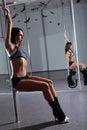 Woman and pole-dance Stock Image