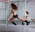 Woman and pole-dance Stock Photography
