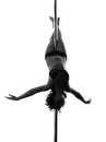 Woman pole dancer crossed knee pose silhouette one dancing in studio isolated on white background Royalty Free Stock Photography