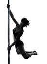 Woman pole dancer silhouette one caucasian dancing in studio isolated on white background Royalty Free Stock Photography