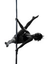 Woman pole dancer silhouette one caucasian dancing in studio isolated on white background Stock Image