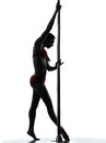 Woman pole dancer silhouette one caucasian dancing in studio isolated on white background Stock Photos