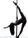 Woman pole dancer silhouette one dancing in studio isolated on white background Stock Photo