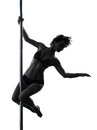 Woman pole dancer silhouette one dancing in studio isolated on white background Royalty Free Stock Photo