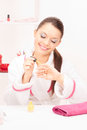 Woman polishing her nails Royalty Free Stock Photo