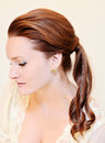 Woman with ponytail a side swept hairstyle Royalty Free Stock Photography