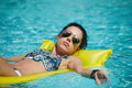 A woman in the pool floats on a blown mattress Royalty Free Stock Photo