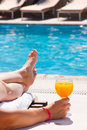 The woman at pool with a juice glass Royalty Free Stock Photo