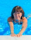 Woman in the pool middle aged Royalty Free Stock Photo