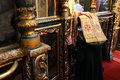 Woman and pope at orthodox woman to confession priest holding head in the church a priest Royalty Free Stock Photos
