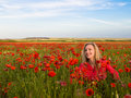 Woman in the poppy field Royalty Free Stock Photo