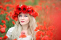 Woman and Poppy Flowers Stock Images