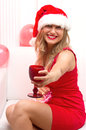 Woman portrait beautiful girl hold wine glass christmas santa hat Royalty Free Stock Image