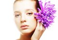 Woman portrait with chrysanthemum spa treatment young Stock Photo