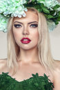 Woman portrait with flowers wreath on head of young beautiful flower Royalty Free Stock Images