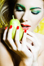 Woman portrait holding a pear Royalty Free Stock Photos