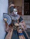 Woman poses in ornate, detailed costume, mask and hat, at the Doges Palace, St Mark`s Square during during Venice Carnival, Italy Royalty Free Stock Photo