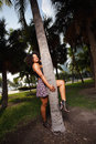 Woman posing around a palm tree stock photo of young jamaican Stock Photo