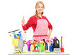 Woman posing with cleaning supplies and giving a thumb up Royalty Free Stock Photo