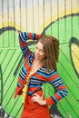 Woman posing in front of grafitti colorful Royalty Free Stock Photos