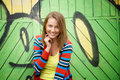 Woman posing in front of grafitti colorful Royalty Free Stock Photography