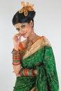 Woman posing with green silk-sari Stock Photos