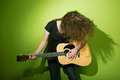 Woman posing with guitar Royalty Free Stock Photo