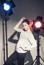 Woman posing in light flashes beautiful studio Stock Photos