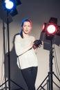 Woman posing in light flashes beautiful studio Stock Photography