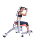 Woman posing on orange hydraulic exerciser Royalty Free Stock Photo