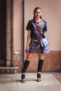 Woman posing outside byblos fashion shows building for milan women s fashion week italy september poses on september in Royalty Free Stock Image