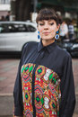 Woman posing outside gucci fashion shows building for milan women s fashion week italy september poses on september in Stock Photo