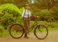 Woman posing with retro bicycle in the park