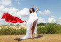 Woman posing wit red fabric outdoor young attractive Royalty Free Stock Photo